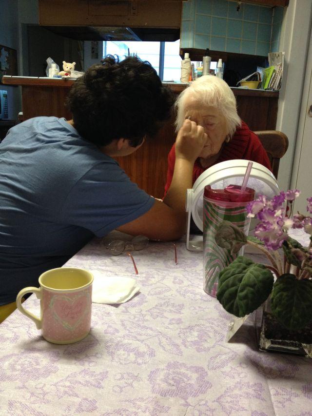 Me helping my grandma pencil in her eyebrows.